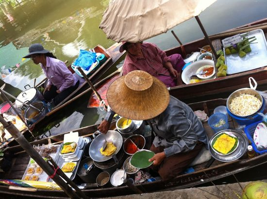Cooking up a storm at Tha Kha floating market.
