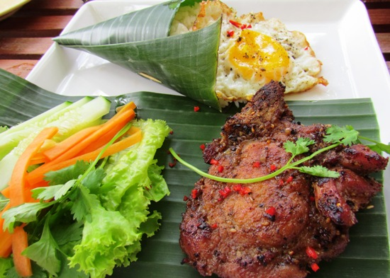 Impeccably presented Thit Heo - grilled pork with a side of rice and egg.