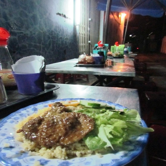 Alley eats; pork and rice.