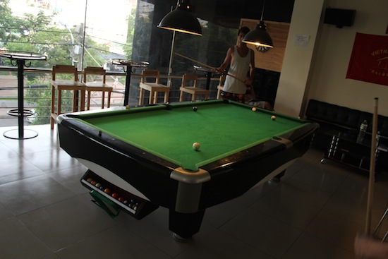 A pool table and a dart board!