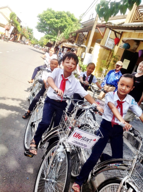 Kids receiving their new Lifestart school bikes.