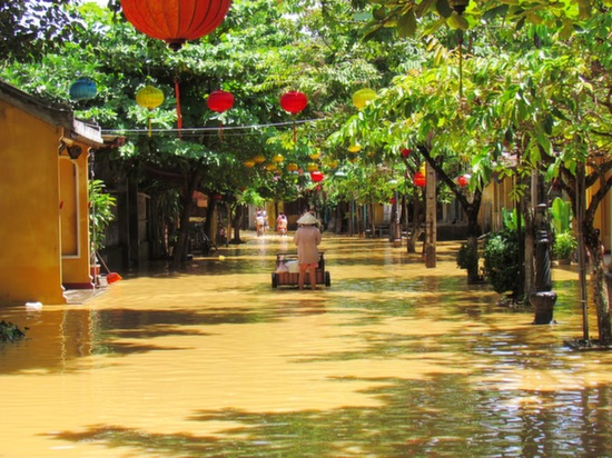 Even heavy flooding can't ruin a photo in Hoi An.