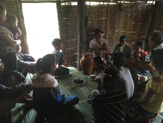 Day 2, Jolong Village: After sharing millet wine in the home of the Village Chief, he invited us to another party celebrating the building of a new kitchen hut.